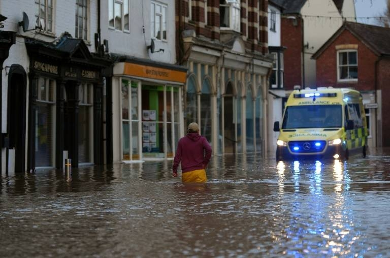 A record 594 flood warnings and alerts were in place Storm Dennis swept across Britain. — AFP