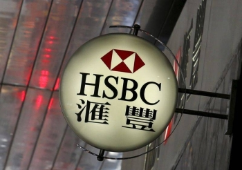 Logo of HSBC is displayed outside a branch at the financial Central district in Hong Kong in this file photo. — Courtesy photo