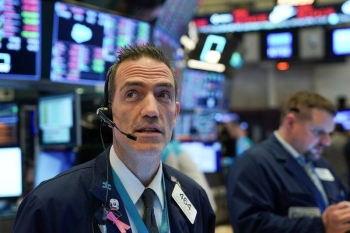 Traders work at the New York Stock Exchange in this file picture. — Courtesy photo