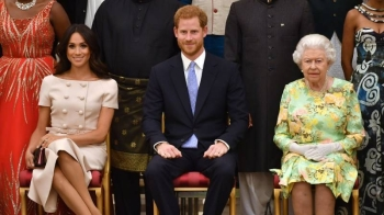 Queen Elizabeth II, right, Prince Harry, center, and his wife Meghan are seen in this file picture. — Courtesy photo