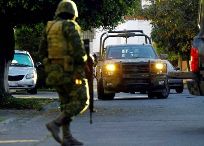 Mexican soldiers pictured taking part in a military operation in January 2014 during which Ruben Oseguera Gonzalez was arrested. — AFP