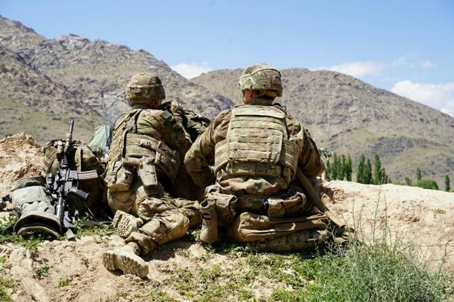 US soldiers look out over hillsides during a visit of the commander of US and NATO forces in Afghanistan in 2019. — AFP