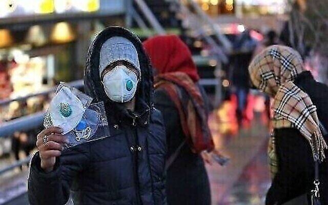 An Iranian street vendor sells protective masks in the capital Tehran in this Feb. 20, 2020 file photo. — AFP