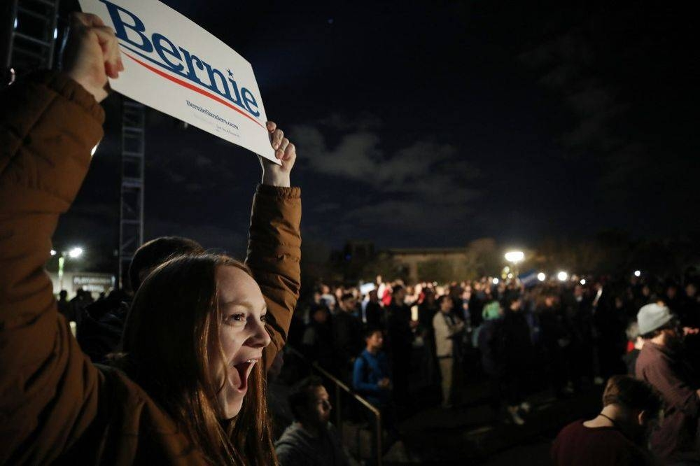 Supporters of Democratic presidential candidate Senator Bernie Sanders gather at a campaign rally for Sanders in Las Vegas, Nevada, on Friday. — AFP