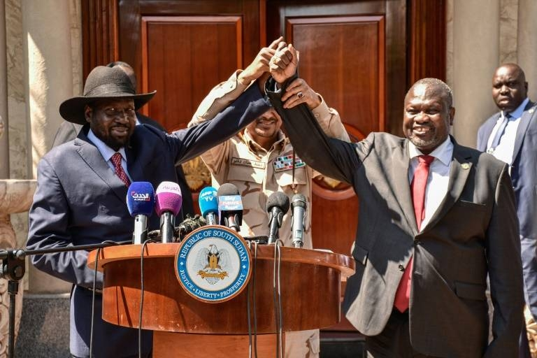Bitter South Sudan Rivals Salva Kiir, left, and opposition leader Riek Machar, right, at talks last year which have finally produced a new government. — AFP