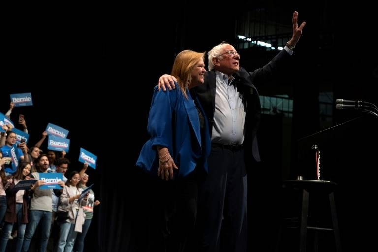 Leftist Bernie Sanders, seen with his wife Jane Sanders, claimed a major victory in Nevada's Democratic caucuses. — AFP