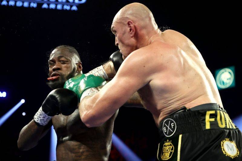 Tyson Fury, right, punches Deontay Wilder during their Heavyweight bout for Wilder's WBC and Fury's lineal heavyweight title at MGM Grand Garden Arena in Las Vegas, Nevada, on Saturday. — Courtesy photo
