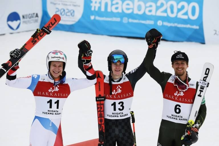 Marco Odermatt, left, Filip Zubcic, center, and Tommy Ford pose for a photograph after the Audi FIS Alpine Ski World Cup Men's Giant Slalom in Yuzawa Naeba, western Japan, on Saturday. — AFP