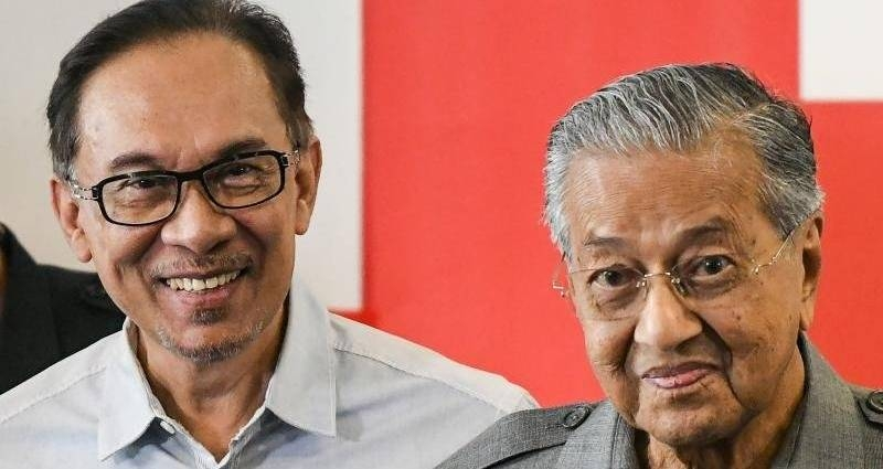 Malaysia's Prime Minister Mahathir Mohamad, right and politician Anwar Ibrahim leave after a press conference in Kuala Lumpur, Malaysia, in this June 1, 2018 file photo. — AFP