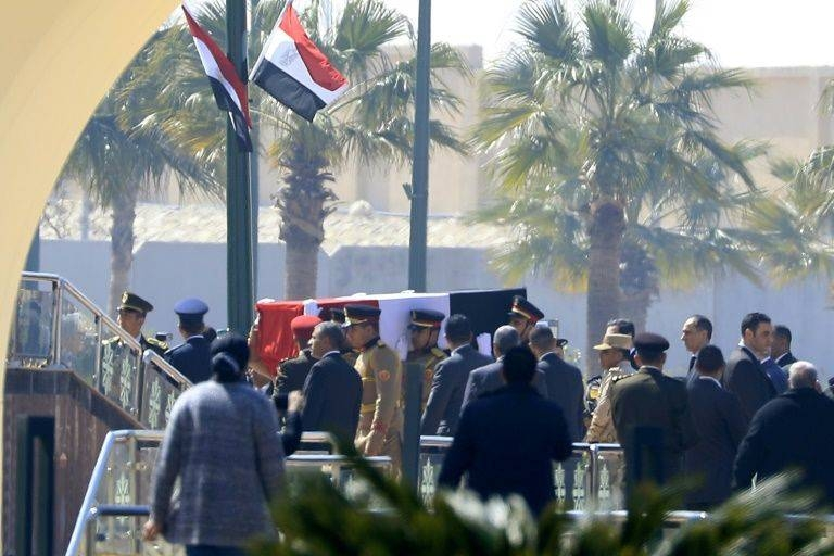 Honor guards carry Mubarak's coffin efore his funeral ceremony.