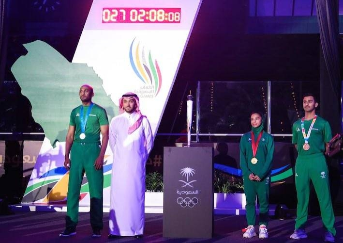 Prince Abdul Aziz Bin Turki Al-Faisal, minister of sports, with Saudi athletes at the launch of the Saudi Olympic Games on Wednesday.