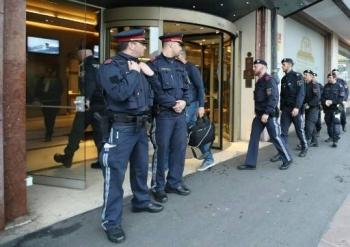 Police officers close a hotel near the city center in Innsbruck, Austria, on Tuesday after a woman who worked here has been confirmed infected with the coronavirus. — AFP