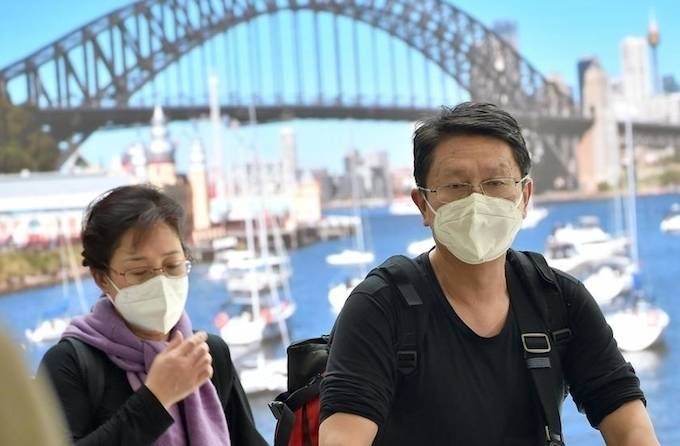Australia's prime minister said the country considered the new coronavirus to be a pandemic Thursday, going a step beyond the WHO as he extended a travel ban on visitors from China. — AFP