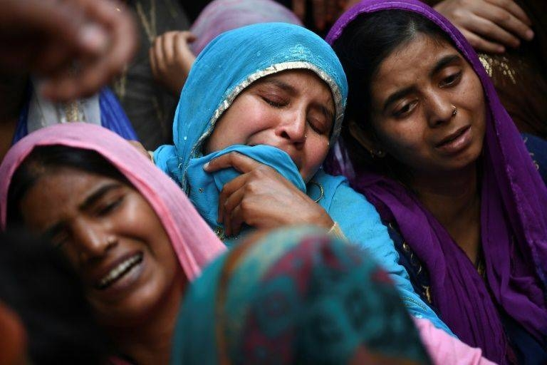 Relatives of Mohammad Mudasir, 31, who died in the sectarian riots in India's captial over Prime Minister Narendra Modi's citizenship law, mourn during his funeral in New Delhi. — AFP