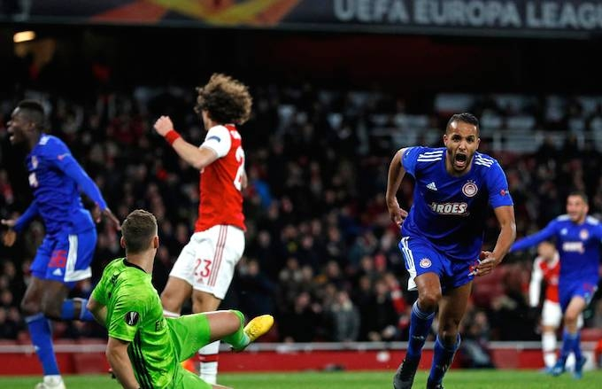 Youssef El-Arabi scored in the last minute of extra-time as Olympiakos knocked Arsenal out of the Europa League on Thursday on a night when four former European champions were eliminated. — AFP