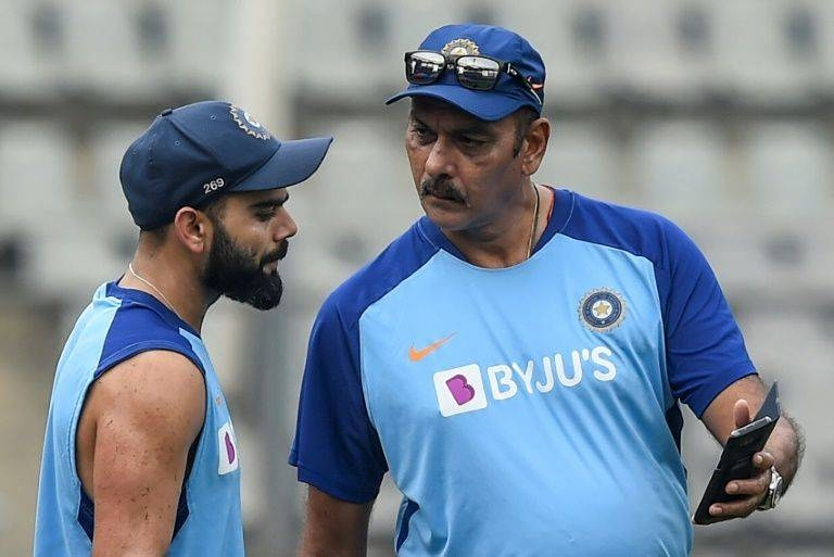 India coach Ravi Shastri (R) said this week's Test defeat was a learning experience. — AFP