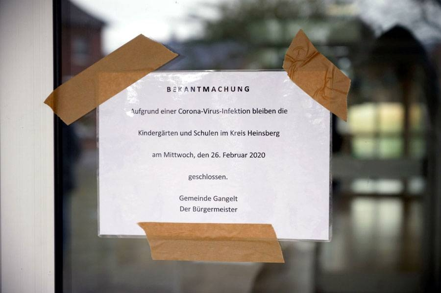 A sign in Gangelt, where the first case in North Rhine-Westphalia in Gangelt was confirmed, states that schools and kindergardens are closed. — Courtesy photo