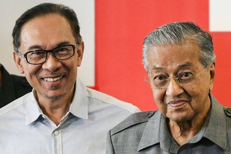 The stormy relationship the two men dates back to the 1990s when Mahathir Mohamad, right, sacked Anwar Ibrahim, left, as his deputy, and he was jailed on dubious sodomy charges. — AFP