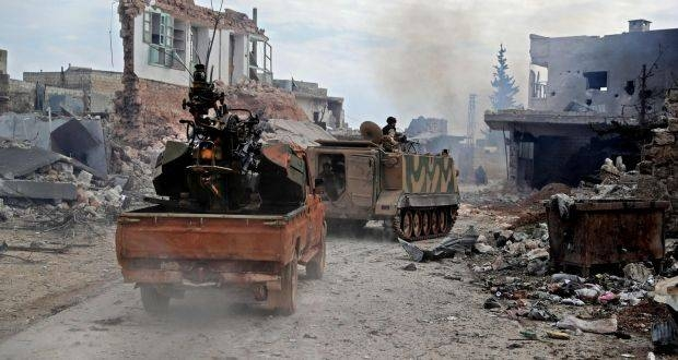 Members of the 'Syrian National Army', an alliance of Turkey-backed rebel groups, followed by a pickup truck mounted with an anti-aircraft gun ride in the town of Sarmin, about 8 km southeast of the city of Idlib, Syria. — Courtesy photo