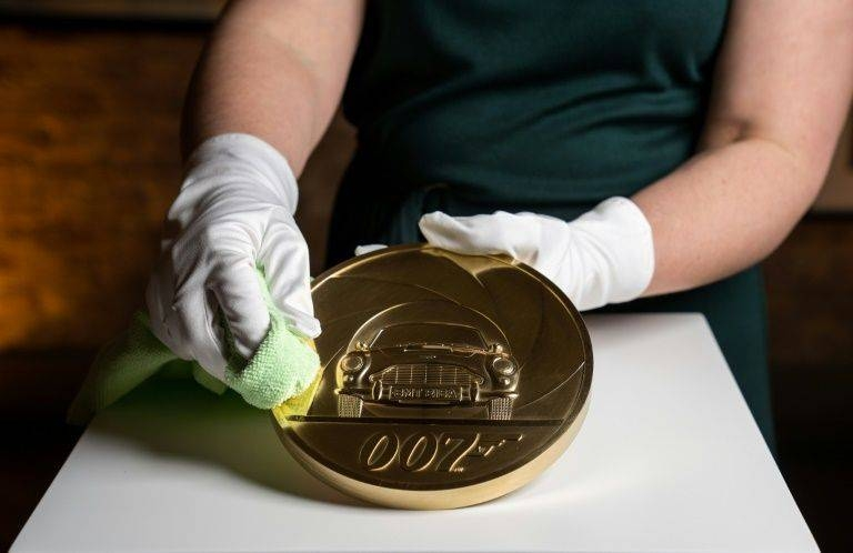 The piece is engraved with an image of the fictional British spy's favorite car, an Aston Martin DB5. — AFP