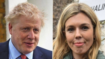 British Prime Minister Boris Johnson and his girlfriend Carrie Symonds are seen in this file combination photo. — Courtesy photo