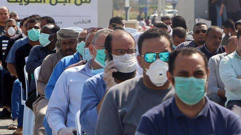 Expatriates returning from Egypt, Syria, and Lebanon arrive to be re-tested at a Kuwaiti health ministry containment and screening zone for the coronavirus in Kuwait City in this file photo.