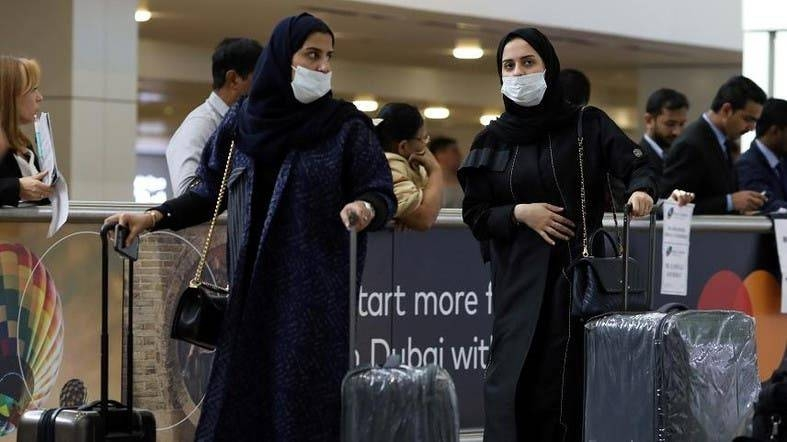 Travelers wear masks as they arrive at the Dubai International Airport in this Jan. 29, 2020 file picture. — Courtesy photo