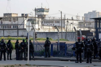 Riot police outside La Modelo prison in Colombia, where a deadly riot over coronavirus fears erupted on Sunday. — Courtesy photo