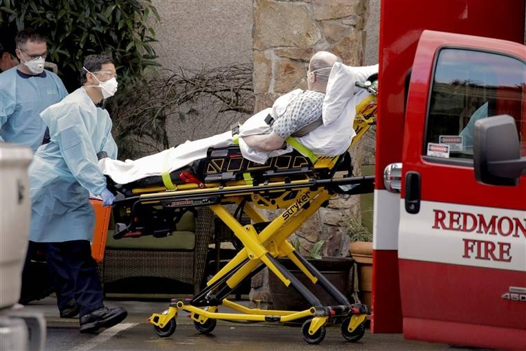A nursing home worker and a medic are seen at the Life Care Center of Kirkland in Washington in this March 7, 202 file picture. — Courtesy photo
