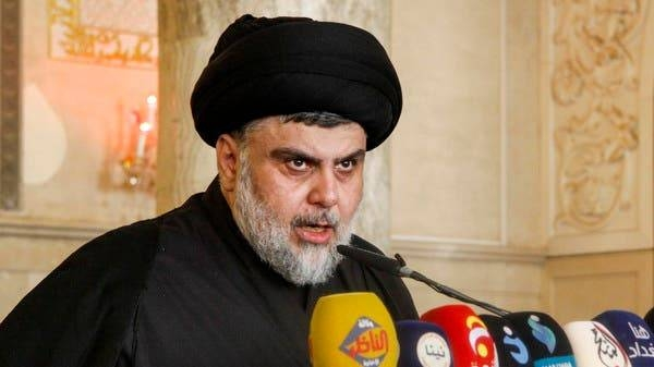 Moqtada Al-Sadr addresses his supporters at the Grand Mosque of Kufa in this file photo