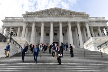Members of the House of Representatives walk down the steps of Capitol Hill in Washington, on Friday, after passing a coronavirus rescue package. -- Courtesy photo