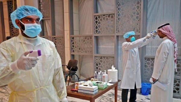 Health Ministry workers scan employees and visitors of the ministry complex, as they arrive to their work, in Kuwait City. -- Courtesy photo