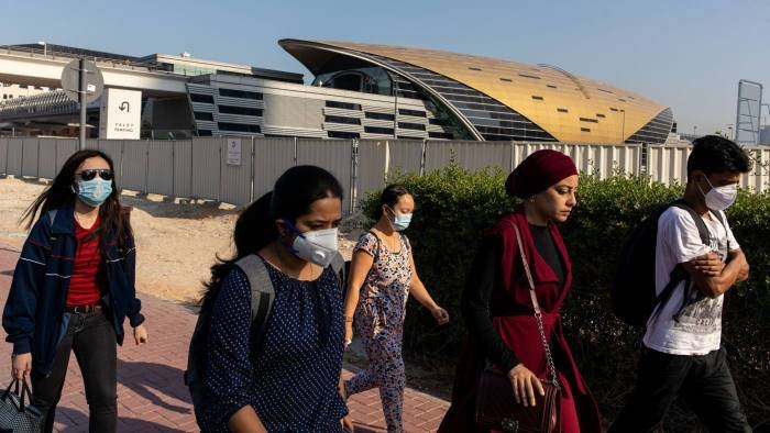 Commuters wear face masks outside a metro station in downtown Dubai in this file picture. — Courtesy Bloomberg