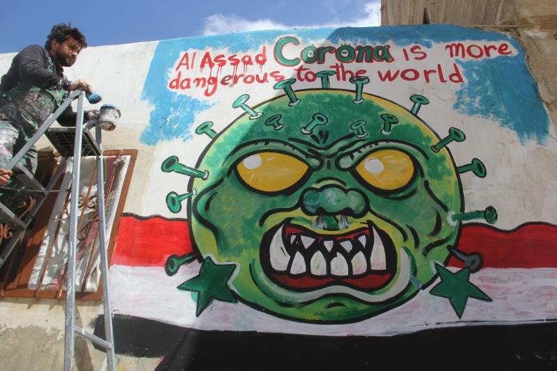 Al-Assad corona is more dangerous to the world, mural by Aziz Asmar in Idlib province.