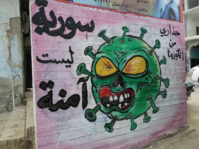 "A mural which reads ""Syria isn't safe"" in Idlib by Aziz Asmar."