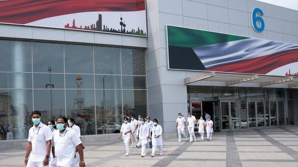 Nurses walk in front of a makeshift coronavirus testing center at the Mishref Fair Grounds in Kuwait city in this file picture. — Courtesy photo