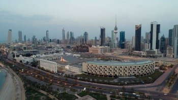An aerial view shows Kuwait City and the National Assembly Building, after the country entered virtual lockdown in Kuwait City. -- Courtesy photo