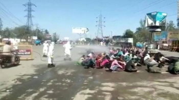 A screengrab of the video shows three people, dressed in protective gear, spraying the liquid directly on a group of workers as they sat on the ground in the city of Bareilly in the northern Indian state of Uttar Pradesh.