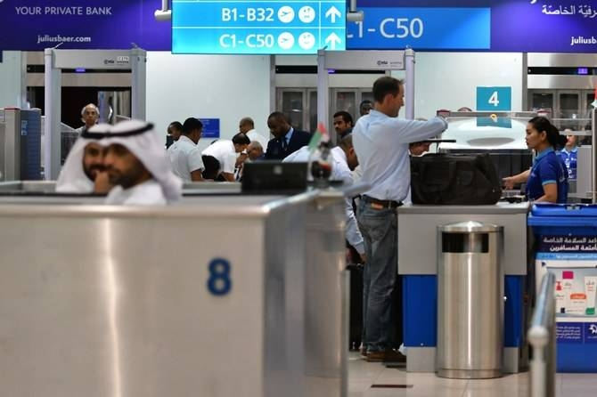Passengers stand at a security gate of Dubai Airport's terminal 3 in the United Arab Emirates in this Oct. 10, 2018 file photo. — AFP