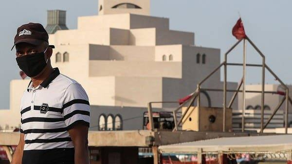 A man wearing a mask walks along the Doha corniche in this file picture. — Courtesy photo