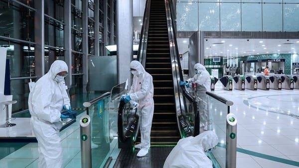 Members of a medical team wearing protective suits clean an escalator in Dubai, after a curfew was imposed to prevent the spread of the coronavirus disease (COVID-19). -- Courtesy photo