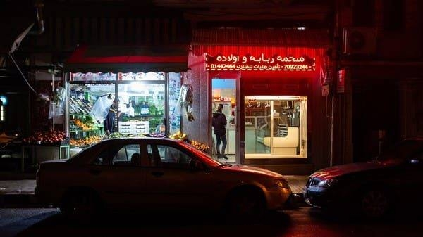 In the normally bustling Mar Mikhael neighborhood of Beirut, a fruit seller keeps his doors open while a butcher prepares to shut down his shop. -- Courtesy photo