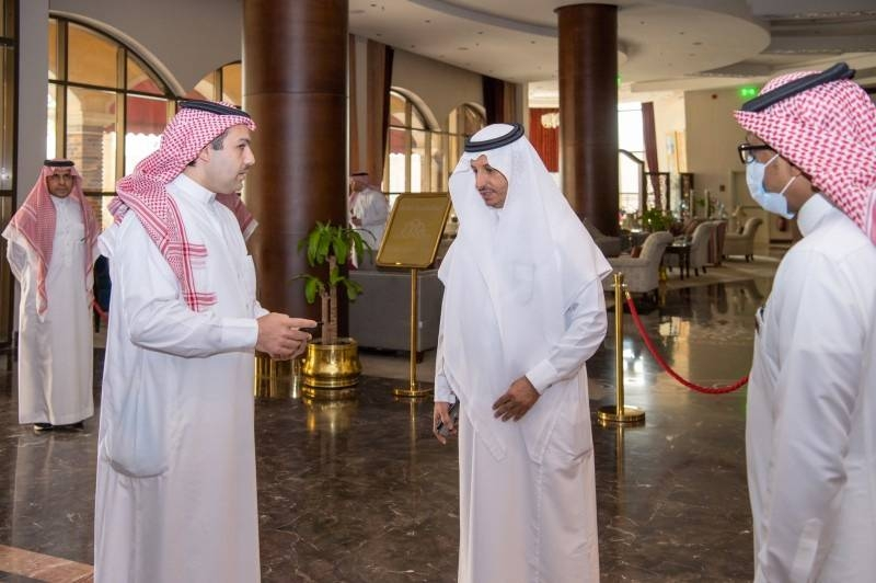 Minister of Tourism Ahmed Bin Aqeel Al-Khatib inspecting a hotel room set out for isolating returning citizens.