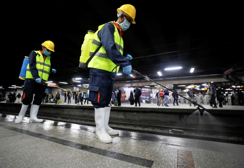 A member of medical team sprays disinfectant as a precautionary move amid concerns over the coronavirus disease (COVID-19) outbreak at the underground Al Shohadaa Martyrs metro station in Cairo. -- Courtesy photo