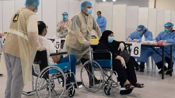 Volunteers help Kuwaitis, arriving from Europe, to do their compulsory testing at a coronavirus testing center, at the Kuwait International Fairgrounds in Mishref. -- Courtesy photo