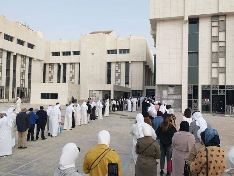 Kuwait government employees line up to get tested for coronavirus in this file picture. — Courtesy photo