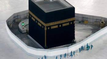Workers disinfect the ground around the Ka'ba, the cubic building at the Grand Mosque, in the holy city of Makkah. — Courtesy photo