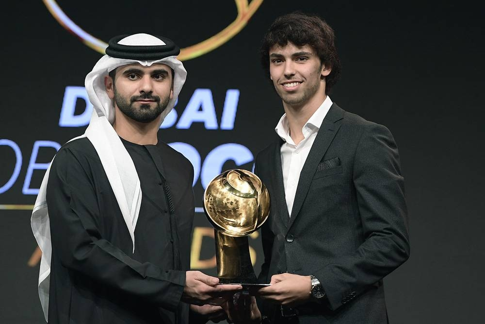Sheikh Mansoor Bin Mohammad Bin Rashid Al Maktoum, the Chairman of Dubai Sports Council, presents Joao Felix with the Best Revelation Player trophy at the Dubai Globe Soccer Awards in December, 2019.