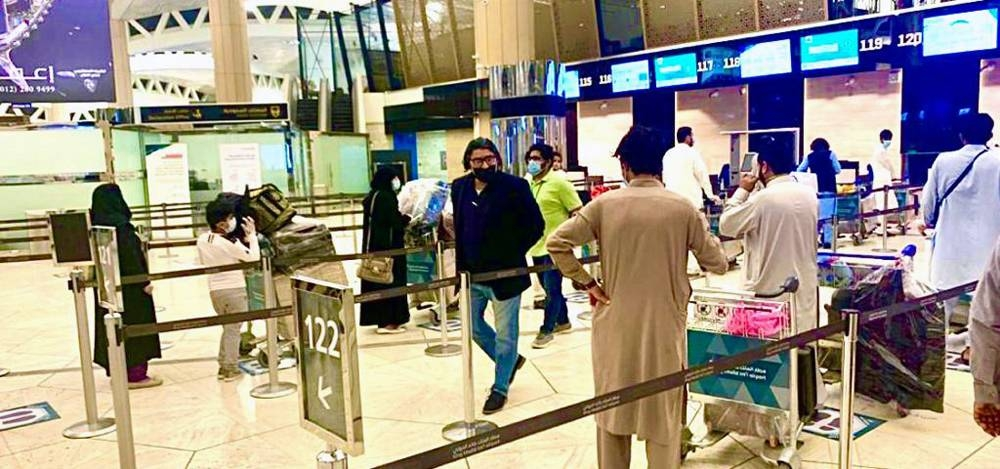 Pakistan Ambassador Raja Ali Ejaz speaks to  passengers before the PIA flight departure to Islamabad.