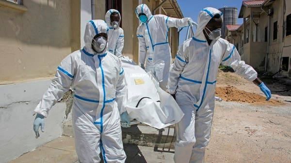 Medical workers in protective suits carry the body of a man who died of COVID-19, before he is buried in Mogadishu, last week. -- Courtesy photos
